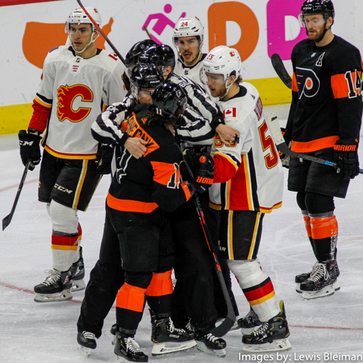 a3317aec1f9 Center Travis Konecny ( 11) of the Philadelphia Flyers is separated by the  referees from Defenseman Noah Hanifin ( 55) of the Calgary Flames